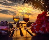 Glasses of wine and the sea — Stock Photo