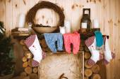 Children's clothes over the fireplace in the house — Stock Photo