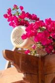 Outdoor loudspeaker hidden among flowers. — Stock Photo