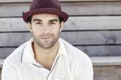 Man in red trilby smiling — Stock Photo