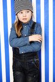 Girl in stripy hat posing — Stock Photo