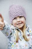 Girl in woolly hat smiling — Stock Photo