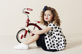 Girl in spotty dress posing — Stock Photo