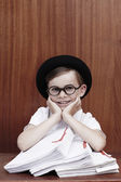 Boy in glasses with paperwork — Stock Photo