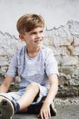 Boy sitting on ground — Stock Photo