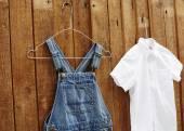 Dungarees and white shirt — Stock Photo