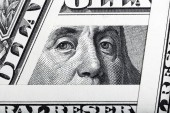 Benjamin Franklin on the one hundred dollar bill framed by one d — Stock Photo