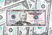 One dollar bills and fifty dollar banknote close-up photo. — Foto de Stock