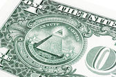 Stack of all seeing eye from a 1 dollar bill isolated on white — Stock Photo