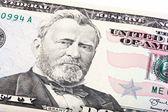 Gestapeld shot van een Amerikaanse vijftig 50 dollar bill close-up van subsidie. — Stockfoto