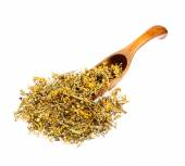 Dried Melilotus officinalis (Yellow Sweet Clower) on the wooden spoon. — Stock Photo