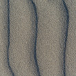 Closeup of volcanic gray sand pattern of a beach in the summer — Stock Photo #58616339