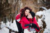 Outdoor fashion portrait of young sensual couple in cold winter weather. Love and kiss. — Stock Photo