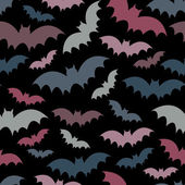 Colorful bats on black seamless pattern — Stock Vector