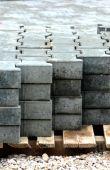 Grey concrete h-blocks on pallet — Stock Photo