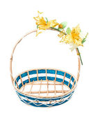 Empty wicker basket with flower on white background. — Stock Photo