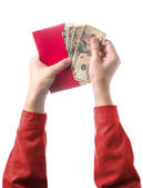 Hand holding chinese red envelope with money isolated over white — Stock Photo