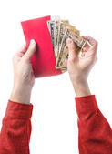 Hand holding chinese red envelope with money isolated over white — Стоковое фото