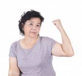 Strong Asian senior female showing off her biceps flexing muscle — Stock Photo