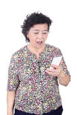 Asian senior female with  mobile phone in hand isolated on white — Foto Stock