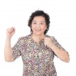 Asian old woman giving punch over isolated white background — Stock Photo #67206207