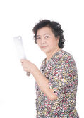 Asian old woman holding chopping knife in hand, isolated on whit — Stock fotografie