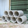 Concrete drainage pipes stacked for construction, irrigation, in — Stockfoto #68748729