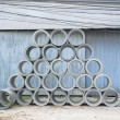 Concrete drainage pipes stacked for construction, irrigation, in — Stockfoto #68748739