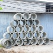 Concrete drainage pipes stacked for construction, irrigation, in — Stockfoto #68748753