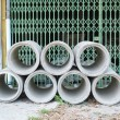 Concrete drainage pipes stacked for construction, irrigation, in — Stockfoto #68748755