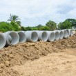 Concrete drainage pipes stacked for construction, irrigation, in — 图库照片 #76200615