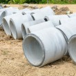 Concrete drainage pipes stacked for construction, irrigation, in — Stock Photo #76200951