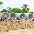 Concrete drainage pipes stacked for construction, irrigation, in — Stock Photo #76201013
