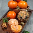 Christmas mood: Mandarins in a Holiday decoration — Stock Photo #59699457