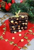 Dark chocolate with hazelnuts in the New Year decor — Stock Photo