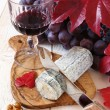 French blue cheese, walnuts, grapes and a wineglass — Stock Photo #60143697