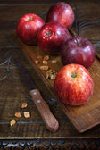 Red Gala apples on an old wooden surface — Stock Photo