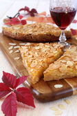 Apple tart, colorful leaves and a wineglass  — Stock Photo