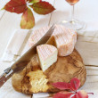������, ������: Autumn composition: red leaves French cheese and wineglass