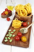 Ingredients Italian cuisine: pasta, tomatoes and olive oil — Stock Photo