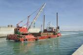 Dredger coming into port — Stock Photo