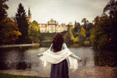 Girl in the forest with castle — Stock Photo