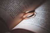 Wedding  rings laying on book — Stock Photo