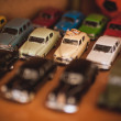 Two wedding rings on top of toy car collection — Stock Photo #62602201
