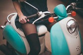 Girl seating on moto bike  — Stockfoto