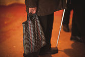 Pure old men holding bag — Stock Photo