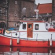 Small red  wooden motor boat tethered on the river dart — Stock Photo #65298927