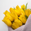 Yellow tulips bouquet on knitted texture background — Stock Photo #67250743