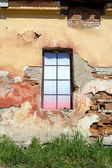 Colorful window in the old building — Stock Photo