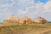 Reconstruction of dwellings of stone century — Stock Photo